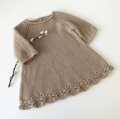 Sizes: months) 6 months year) 2 years years) 6 years years) Complete length: 37 47 61 cm Half chest circumference: 24 29 35 cm Sleeve length: 12 18 23 cm Amount of yarn: 100 150 250 g Needles: Circular needle 3 mm cm), d Knitting Short Rows, Knitting For Kids, Lace Knitting, Knit Crochet, Baby Cardigan Knitting Pattern Free, Baby Knitting Patterns, Baby Patterns, Knit Baby Dress, I Cord