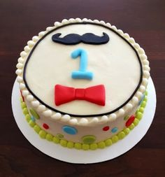 little man 1st birthday cake by Snacky French