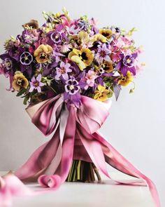 yellow pansies, lilac brodiaea, pink icia, & purple columbines