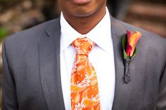 Orange tie with grey suit and calla lily!