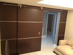 Exclusive wall panel and barn door. Perfect architectural dimensions to compliment your modern space.  Featuring the finest Italian veneers, stainless steel strips, and modern door hardware, it'll rejuvenate your interiors and bring your decor to life.