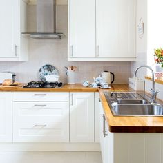 White modern Shaker-style kitchen with wooden worktops