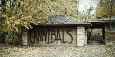 """Kat snarled, the noise filling the air like a motorcycle being kickstarted, as she stared at the word spray painted across the cabins. """"Who the fuck did this?"""" She asked her voice low."""