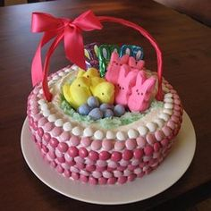 """Easter Basket Cake   """"Such a cute idea. I tried it two ways: once with the candies, and once with the forked basket weave look. Both were adorbs. If you're frosting challenged, the candy makes it all seem tidy and pretty, and if your cake is a little lopsided, well, that's just very basket-like, isn't it?"""""""