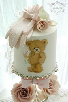Beautiful Bear Cake topped with pastel pink gloves and roses