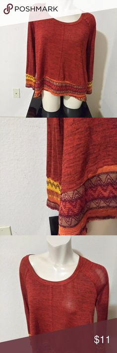 C. Oliver Brownish red Aztec print design Sz M Rusty Brownish red crew neckline with Aztec print around the bottom and cuffs of the blouse.Like New C. Oliver Tops Blouses