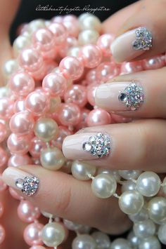 The ultimate feminine elegant jeweled pink nails--cradling gobs of pink and white pearls! <3