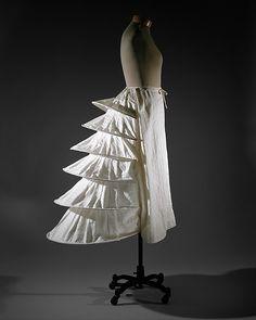 Bustle Date: ca. 1871 Culture: British Medium: cotton, metal Dimensions: Length at CB: 39 in. (99.1 cm)