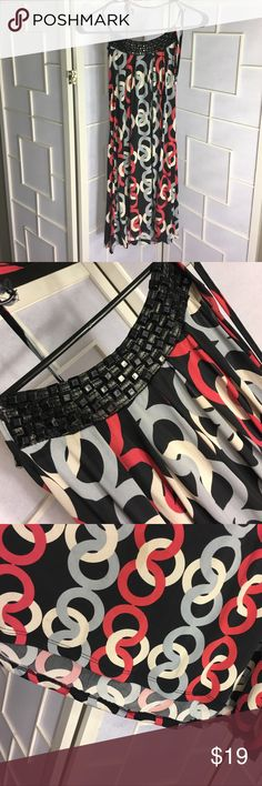 Black red and grey dress.  Lose fitting.  Silky Favorite dress in my closet because it just flows and is so flattering.  Ties around the neck.  Beautiful black beads around the top.  Little bit of wear on the string but still has a lot of life left! Body Central Dresses