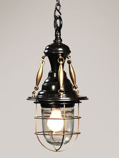 a brilliant combination of dark metal and antiqued brass, the sassafras pendant has style to spare.  elegant brass bobbles loop into an industrially inspired metal bulb cage for a look that is as whimsical as it is practical.  the perfect slender pendant for any island, vanity or bath, we'd love to see the sassafras hanging over a bedside table or two.