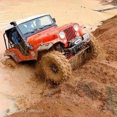 Jeep CJ-5 having fun in the mud                              …