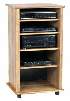 Solid Hardwood Ebony 4-Shelf Audio Cabinet by Wood Technology. Save 30 Off!. $479.95. Color: Ebony. Adjustable solid hardwood shelves resist warping. Matching wood veneer side panels. Laminate back panel hides wires and cables, adds stability. Solid ash hardwood fluted trim, solid hardwood, top, bottom, and shelves. AR-43-E Features: -Made of solid hardwood that resists warping.-Three adjustable shelves and one center fixed shelf.-Made in the USA.-Fixed center shelf. Includes: -Includes four…