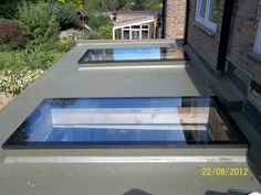These contemporary skylights add plenty of natural light to this flat roof extension. Contemporary Skylights, Contemporary Front Doors, Flat Roof Skylights, Roof Extension, Extension Ideas, Kitchen Extension Flat Roof, Orangery Extension, Extension Google, Roof Lantern