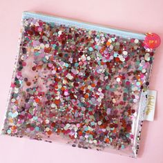 confetti pouch!! I NEED this!!! $22 from packed party, also carried at paper source for $22.95