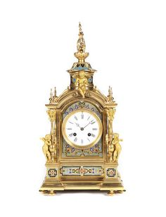 A late 19th century French gilt brass and champleve enamel mantel clock