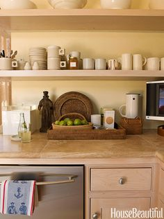 """""""Baskets and trays are very homey and useful, not just for carrying things but also to organize collections,"""" says designer Patrick Wade about his 60 square-foot kitchen."""