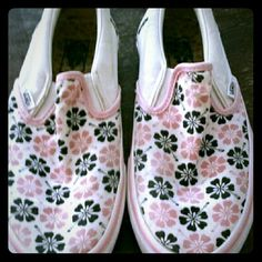 White And Pink Floral Vans Slip On's This is a cute pair of slip ons from Vans.  They are white and have pink flowers all over them.  They are size 8.5 and do show signs of wear, but still have a lot of life in them! #vans Vans Shoes Flats & Loafers