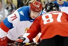 Evgeni Malkin prepares for a faceoff against Penguins teammate Sidney Crosby in…