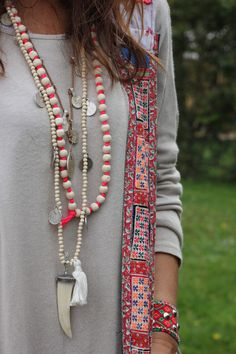 I like the Grays and Pink Coral colors in this mix of necklaces. Boho Style