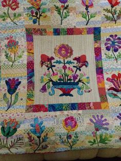 Appliques from a Kim  McLean pattern.  Wall hanging I did with Kaffe Fassett fabrics and multi pieced backgrounds.