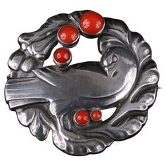 Georg Jensen. Design no. 123. Sterling silver and coral dove brooch.  MArks: 'GEORG JENSEN' in an oval of dots, 'STERLING DENMARK' and '123'.