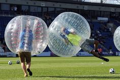 I WANNA PLAY BUBBLE SOCCER IT LOOKS SO FUN I WOULD BE THAT ONE PERSON JUST PUSHING PEOPLE OVER ON THE FIELD AND ROLLING ON THE FIELD.