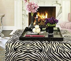 Ideas for Ottomans - Zebra Ottoman decor perfect for a coffee table.