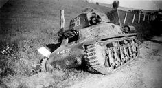 Abandoned R35 light tank on the side of a road, France, May 1940