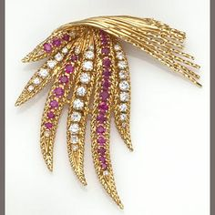 A ruby, diamond and eighteen karat gold brooch, Sterlé. Brooch in a fern motif, set with circular-cut rubies, round brilliant and single-cut diamonds; retailed by C.Montreaux, signed Modele Sterlé, Paris; estimated total diamond weight: 1.85 carats.
