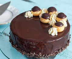 This Profiterole Cake is a rich decadent impressive dessert that will satisfy both chocolate and profiterole lovers. The cake is made with a moist cocoa brow. Chocolate Cheese, Chocolate Glaze, Chocolate Orange, Cream Cheese Filling, Cream Cheese Frosting, Profiteroles Recipe, Cocoa Brownies, Impressive Desserts, Kinds Of Desserts