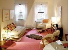 rug-on-rug & window dressings: Take down those ugly plastic blinds and dress your windows with something a little nicer: roman shades, floor-length curtains, a screen-printed panel... anything that will soften up your room and complement your decor.