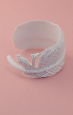 I love cuffs and feathers! a feather cuff means I double LOVE!