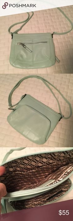 """NWOT Tignanello Aqua Buttery Leather Crossbody Bag Never worn, brand new, but took off tags. This leather is an absolutely gorgeous color and the softest I may have ever felt. Love the color and bag but is too small for me. Drop of strap is adjustable but can be 23"""", multiple leather trimmed pockets inside and out. Lots of slots for cards and ID. Very rare color, difficult to find. Tignanello Bags Crossbody Bags"""