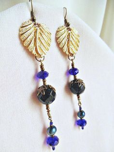 #elegancebydorianne #victorianearrings #victorianstyle #victorianjewelry #blueearrings  #pearlearrings #crystalearrings #etsyjewelry #etsyshopowner #giftforher  Delightful Victorian Inspired Gold Leaf Earrings with Blue Gold Stone. Created with lovely re-purposed vintage gold tone leaves and marvelous cobalt blue crystals, and luminous blue pearls! More about this design, on Etsy!