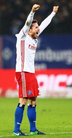 Nicolai Müller of Hamburg celebrates the first goal scored by Filip Kostic during the Bundesliga match between Hamburger SV and FC Augsburg at Volksparkstadion on December 10, 2016 in Hamburg, Germany.