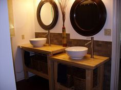 I love this bathroom setup, and the sink stands are repurposed IKEA kitchen islands