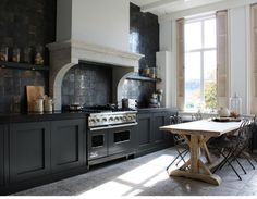 Large backsplash dark cabinetry + tile in beautiful kitchen