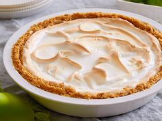 Bubba's Key Lime Pie  Crust: 5 tablespoons butter, melted 1-1/2 cup graham cracker crumbs 1/2 cup slivered almonds Filling: 1 (14-ounce) can sweetened condensed milk 1/2 cup Key lime juice 1 teaspoon grated lime zest 2 egg yolks Meringue: 2 egg whites 1/4 teaspoon cream of tartar 1/4 cup sugar 1 teaspoon grated lime zest