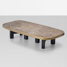 Ado Chale coffee table Belgium, c. 1975 cast bronze, enameled steel 55.5 w x 28 d x 12 h inches Incised signature to edge: [Chale]