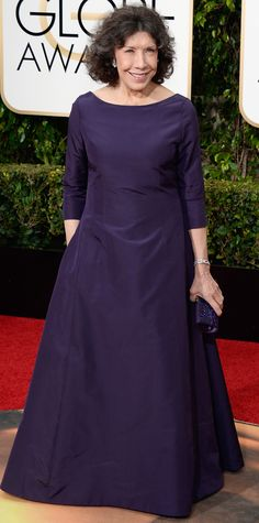 Lily Tomlin in a deep violet gown