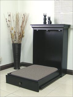 <3  lol this is a dog bed!!! In studio apartments they have the same idea. Bed is in the wall and folds down. I like this idea. Perfect for a spare bedroom or den.