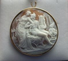 """Paris and Helen by Giovanni Noto Materials: Sardonyx shell, 18k gold marked.  Size: just under 2 1/8"""" diameter.  Date and Origin: circa 1925 Italy, signed by artist Giovanni Noto."""