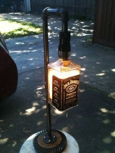 I made this lamp out of galvanized pipe and a Jack Daniels bottle. The bases is a rear differential gear out of a car rear axel. Liquor Bottle Crafts, Alcohol Bottles, Liquor Bottles, Glass Bottles, Liquor Bottle Lights, Lampe Jack Daniels, Jack Daniels Bottle, Galvanized Pipe, Tiki Torches