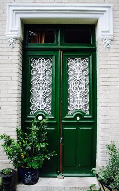 Stunning green doors with beautiful ironwork are so eye-catching. Can we have?