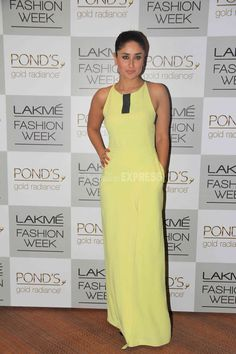 Kareena Kapoor cut a slender figure in a pale lime green Osman gown. Heavy kohled eyes and a pulled-back hairdo completed her look as she attended the Day 3 of Lakme Fashion Week 2013 in Mumbai on Sunday afternoon.  Kareena was cheering for her elder sister Karisma Kapoor, who walked the ramp for designer Vikram Phadnis. (Photo: Varinder Chawla)