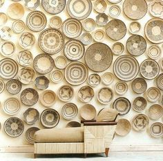 Stephen Falcke - wall covered with local woven vessels