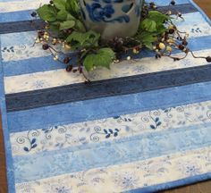 Soothing and cool, Quilted Table Runner in assorted blue floral by WarmandCozyQuilts, $42.00  #pcfteam