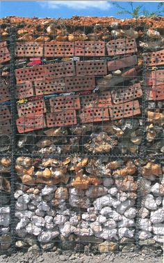 Ivan Hicks, London England. Gabion modules made from a collection of found objects, building bricks and flints. From Contemporary Color in the Landscape by andrew wilson
