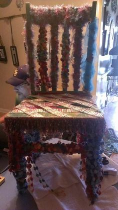 Wild Thang chair. Covered in pom pom yarn, eyelash yarn and ribbon. Display piece, but can be duplicated. Each piece is individual. Each piece will be an original design.