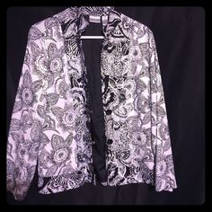 Beautiful thin blazer from Chico's Gorgeous black and white floral oriental style pattern blazer. Perfect to dress up any outfit. The top two buttons are made to be open, the bottom buttons do button. Gently worn, perfect condition. Chico's Jackets & Coats Blazers
